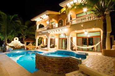 Luxury house for sale, Puerto Aventuras, Riviera Maya, Mexico - pool & house at night