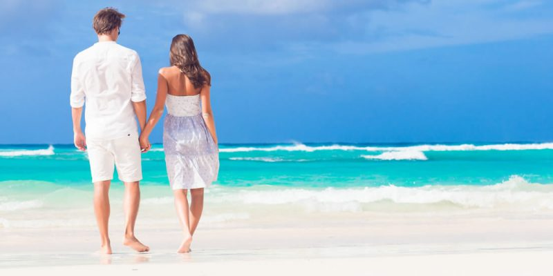 Couple walking on the beach in the Caribbean