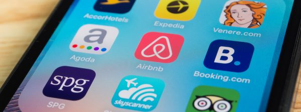 Airbnb's website and mobile app - making it easy for travelers to book accommodation and for home owners to make extra money