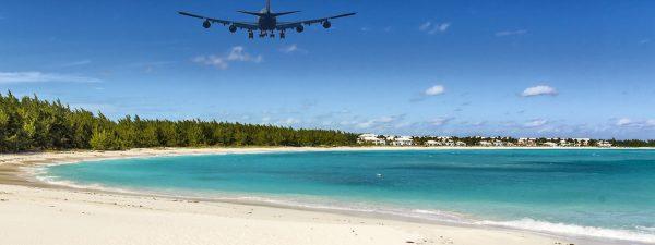 Airplane flying over Emerald Bay, Exuma in The Bahamas