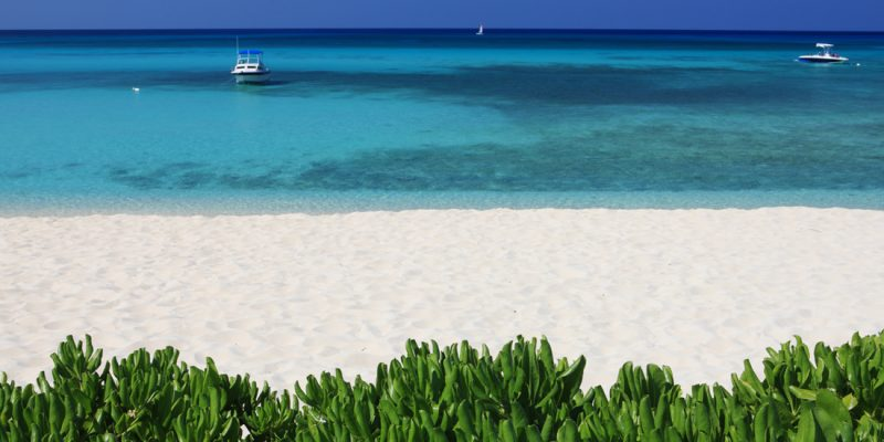 Boats bobbing on the water viewed from Seven Mile Beach, Grand Cayman in the Cayman Islands