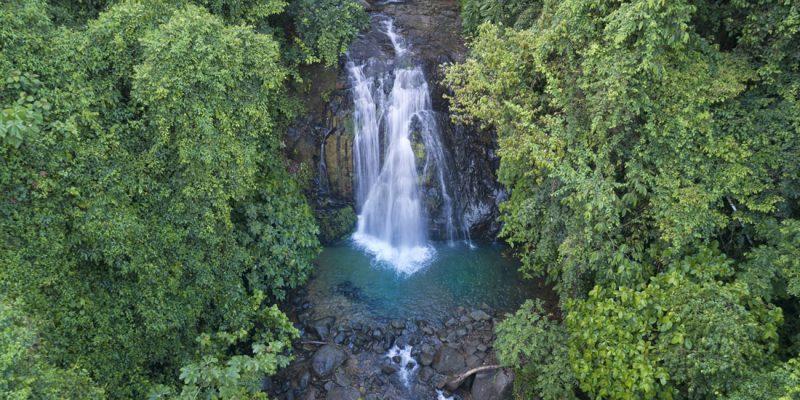 Waterfall nestled in rainforest in Marino Ballena National Park, Costa Rica