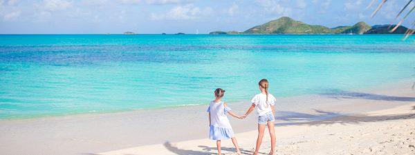Girls on the beach in Antigua