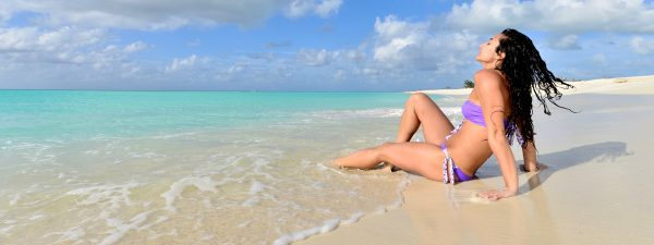 Sunbathing on the beach in the Turks & Caicos Islands