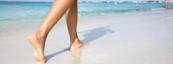 Woman walking on a beautiful beach in the Cayman Islands