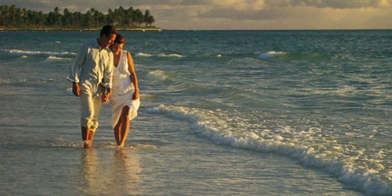 Couple walking on the beach in The Bahamas
