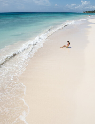 Aerial view of woman on the beach in Barbados